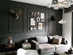 Molduras na parede preta, minimalista e nórdico