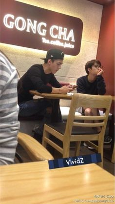 D.O and Sehun at a bubble tea shop. 10/01/14 Slightly stalkerish looking photo but whatever