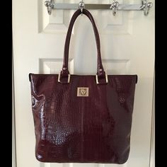 Anne Klein Large Burgundy Gold Glossy Tote Bag Gold hardware.  Back zip pocket.  3 compartments (middle zips).  3 interior pockets (1 zips).  Man made.  Good condition.  Measures: 15x5.25x12.5x8.75. Anne Klein Bags Totes