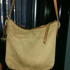 Cute coach  cross body tan has been used very cute Tan cross body long strap inside very clean has some discoloration on the bottom from wear no damage to the corners  Very nice bag trade value 85 Coach Bags Crossbody Bags