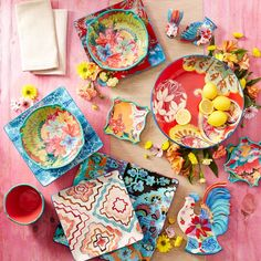 Brighten up a summer cookout with colorful dinnerware and fresh flowers.
