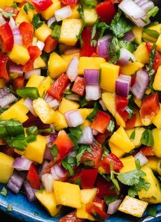 This colorful mango salsa recipe is so easy to make! It's sweet, spicy and absolutely delicious. Fresh mango salsa is great with chips, on tacos and more! Mexican Food Recipes, Vegetarian Recipes, Cooking Recipes, Healthy Recipes, Healthy Grilled Chicken Recipes, Shrimp Taco Recipes, Shrimp Tacos, Fish Tacos, Juice Recipes