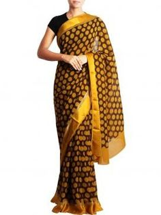 Check out this stylish and classy dark chocolate color base with yellow-occur polka dots all over the body from Designer      Kapde.Which is a pick for an upcoming dasara festivals.