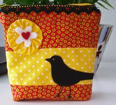 Cosmetic bag. Decorated with lace, flower and felt applique.