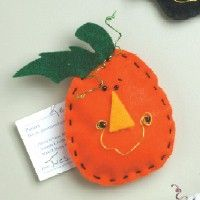 Pumpkin Magnet Craft. Easy beginning sewing craft. Pattern and instructions on freekidscrafts.com