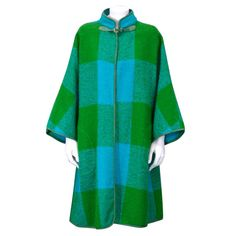 Suede trimmed Blanket Coat.  Bonnie Cashin for Sills car coat in green/turq. plaid boucle with suede piping.  Clean-lined Kimono style sleeves with single suede buckle closure at neck and side seam pockets.