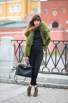 Julia Kalmanovich in a Fendi coat with an Alexander Wang tee, Fendi bag and YSL shoes.