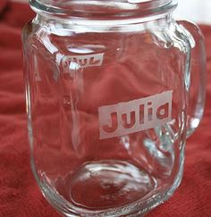 Glass etching... you could cut your design out of contact paper too so that the lettering or design is the etched part rather than the background.