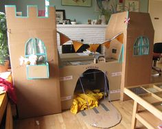 oh to be a kid again... seriously cool fort. tucking this one away for 'aunt of the year' award :)