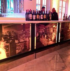 """Vintage pictures of a company at the event""""s bar. Décor by stemeventspr.com"""