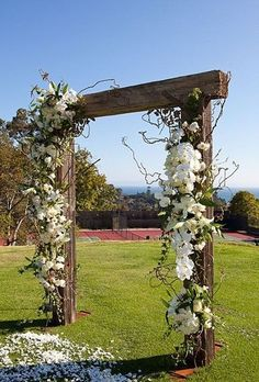 Alan wants to make an archway similar to this. With an old bull skull he has on it...barbed wire/ropes/horseshoes on it. Idea to take the crossbeam down during the ceremony and brand each other's brand on it. Then it can be a board we take with us wherever we go.