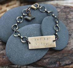 and+so+i+fly+.+a+hand+stamped+soul+mantra+bracelet+by+lizlamoreux,+$32.00