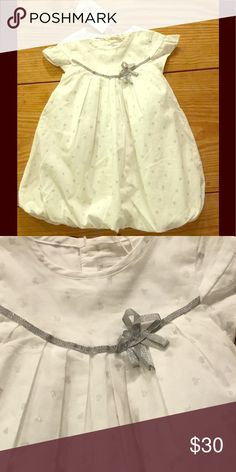 Bubble hem dress w/ silver heart print & ribbon Catamini bubble hem dress w/ silver metallic heart print & metallic ribbon at yoke. Also pleats at yoke. Delicate cap sleeves.Fully lined. Catimini Dresses Casual