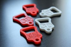 The final product: 3D-printed red and white bottle openers for our pals at Grace in the Kitchen in Kanata, Ottawa, ON. Thanks for reaching out you guys! Enjoy your bottle openers.