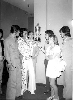 September 3rd 1973 backstage in Las Vegas - Robert Maxwell from Scotland The Elvis touch (Glasgow fan club) is on the right The guy next to Elvis on right is Jimmy McNally.