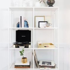 """It's super easy to switch things up on your shelves to suit your space, I swapped my cookbooks for my style & design ones and added a gold tray full of stationary - perfect for when I need to quickly write down some ideas, or a grocery list! 😉 This shelving unit is at such a great price point and I love that it isn't too bulky since this is a small room, my friend @ashddesign worked in my record player to it to change up the space too!"" - @bonjourblissblog for #LTKathomewith 