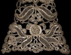 Stomacher Place of origin: England, Great Britain Date: 1740-1750 Materials and Techniques: Silver bobbin lace Museum number: T.80:B-1948 | V&A