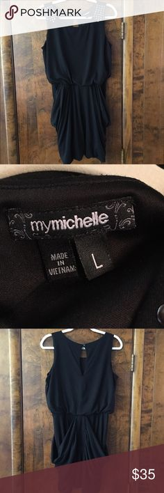 """My Michelle Black Dress Short Black Dress with Stud Embellishments on the Shoulders.  Drape Side Pockets. Cute and Comfortable to Wear.  72% Polyester 24% Rayon 4% Spandex. Shoulder to Hem is 35"""". Elastic Waist to Hem 17"""".  Shoulder to Waist 18"""". My Michelle Dresses Mini"""