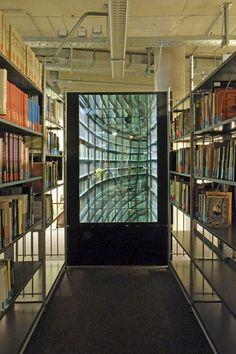 """Nicolas Grospierre's Infinite Library"" by Michael Lieberman via Book Patrol  Nicolas Grospierre The Never-Ending Corridor of Books lightbox and mirrors 1"