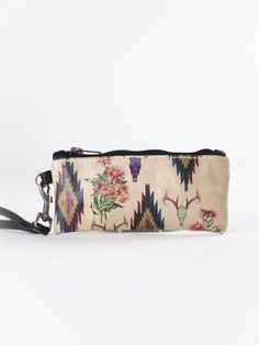 Mixed Print Lipstick Pouch. Mixed prints of deer skulls flowers and Aztec designs.  This tiny little lipstick pouch is perfect for all your little necessities!  Made in the USA by Totem Salvaged Western style. Rodeo fashion. Boho chic. therollinj.com