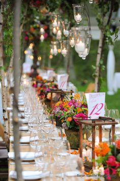 This farm table is perfect for a spring wedding with romantic lighting