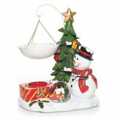 This Snow Globe Collection Wax Melts Warmer will bring out the kid in everyone!