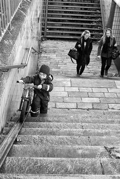 Getting that bike up the stairs.