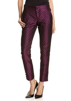 RED VALENTINO Pant with Metallic Floral Pattern Skinny leg pant Banded waistband Features allover floral pattern design with metallic accents throughout Sliding clasp closure with zipper-fly 3-pocket styling 3-button accent at leg opening Pull on style Fully lined Material: 99% Polyester 1% Polyamide, Lining: 64% Acetate 36% Modal $420.00