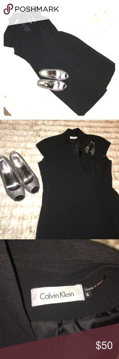 Size 6, Gorgeous Calvin Klein Black Dress in EUC Cute black cap sleeves with a mandarin collar.  Dress wraps around to a sleek black 3 snap clasp. Gorgeous tailoring makes this dress fit like a glove. High quality craftsmanship with silky black lining. Calvin Klein Dresses