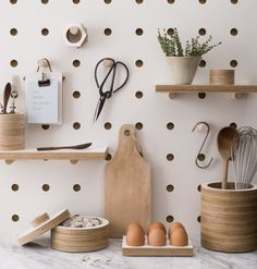 Ever since Julia Child popularized the idea of using a pegboard to hang pots and pans decades ago, the basic wall unit has been a feature of home kitchens. But even old standards could use a little up