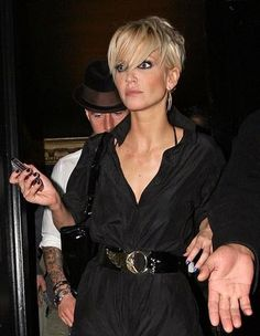 and another of Sarah Harding. ...really, I think the dark eye make-up beneath the boldly bleached bangs is a key choice...