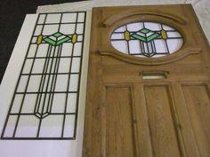 reclaimed exterior front door with stained glass circle with side window, Front Door Molding, Pattern Glass, Glass Front Door, Exterior Front Doors, Front Door, Moldings And Trim, 1930s House Exterior, Stained Glass Door, Doors