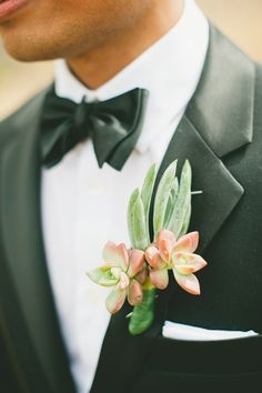 green and pink succulent boutonniere with black tux - photo by OneLove Photography