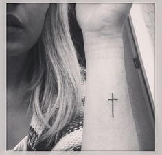Symbol cross. I've looked at a lot of cross tattoos for the back of my neck or my wrist, but this is one of my favorites...simple & stylish.