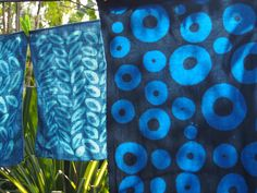 Table runner (foreground) and napkins, soy wax resist applied with brush, indigo dyed.