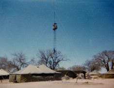 11 July, B Coy, 3 SAI arrived after flying into Grootfontein. Most of 6 SAI then leave. Interesting photo showing a troopie climbing up for guard duty in the crow's nest. West Africa, South Africa, Brothers In Arms, Crow's Nest, Defence Force, Essay Topics, Military Life, Photo Essay, Troops