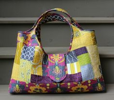 A Quilter's Table: A Tinker Tote. Love Debbie's version of this bag - the mustard, gray and plum colors are great for fall.