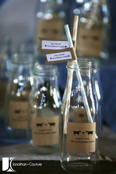 Old Fashioned milk bottles as place card holders!