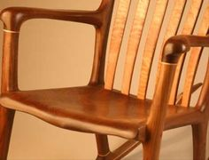We found these amazing hand-crafted wood rocking chair pictures. The chairs are handmade by Bill Lindau.
