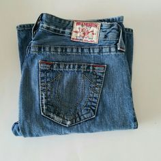 "True Religion Jeans "" BOBBY Boot Cut Authentic jeans from True Religion,  great pair of blue jeans,  going well with many outfits,  been worn few times very gentle and it is good condition. Light wash and distressed style  and the front and back.  Measurements are length 41"" inseam 32"" waist 32"" hip 38"" True Religion Jeans Boot Cut"