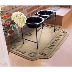 Personalized Paws & Bones Waterproof Dog Food Mat holds gallons of water, is eco-friendly & looks great in your home. Indoor & outdoor friendly!