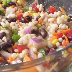 "Barley Lime Fiesta Salad | ""Barley, corn, black beans, and colorful veggies team up with a cilantro-lime dressing to make a different cold salad. Mix the dressing to your own tastes."""