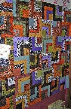 half log cabin quilt. A charm pack and jelly roll would work.