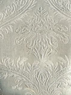 A gorgeous textured damask wallpaper from the book Metallic World at AmericanBlinds.com #wallcovering #silver