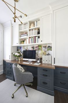 Pretty sure this is my dream office. Love the dark blue gray lower desk cabinets, wood top and white uppers. Beautiful home office idea. Vanessa Francis Design #homeofficeremodel