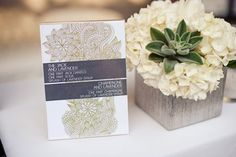 love this invitation & flower arrangement w/succulents