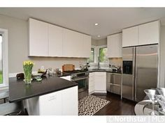 Nice use of a small space in this renovated kitchen in a home that's for sale in Minneapolis. #white #kitchen