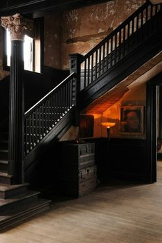 Clean black staircase with antique walls <3