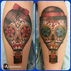 My sugar skull hot air balloon tattoo by Jack Hatchet. On my calves.