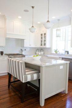 striped bench creates interest in neutral kitchen; fun seating option
